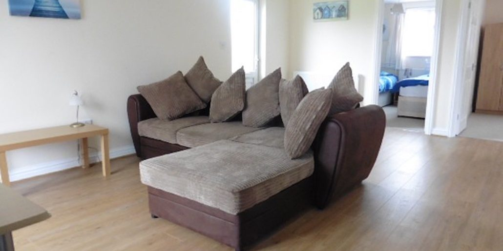 brown corner shaped sofa