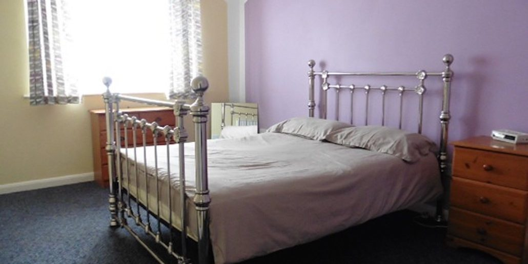 double bed in a purple bedroom
